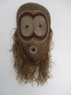 HAND CARVED WOODEN AFRICAN WALL HANGING MASK WITH STRAW DETAIL (listing %9)