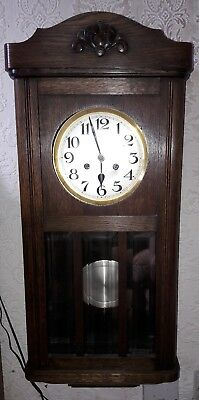 Early 20th Century Oak Cased Wall Clock With Silvered Dial.