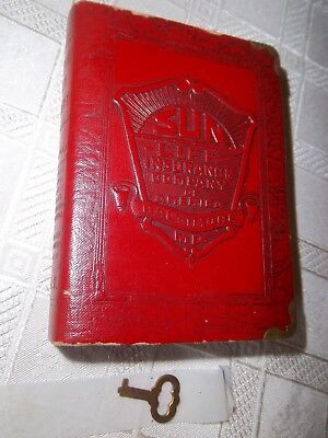 Vintage red Sun Life Insurance book bank with key, lock is touchy but works.