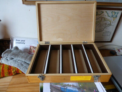 Crafted wooden 35mm slide box. Some scratches on surface and old labels.