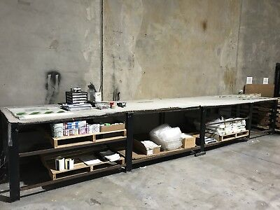Steel Workbench with chipboard shelves and top.