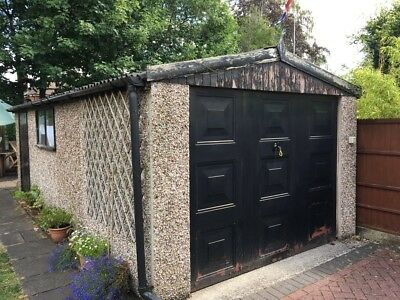 Concrete sectional garage (used) -up and over door, needs newroof