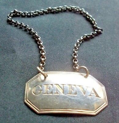 "A George III engraved silver ""Geneva"" wine decanter label 1814"