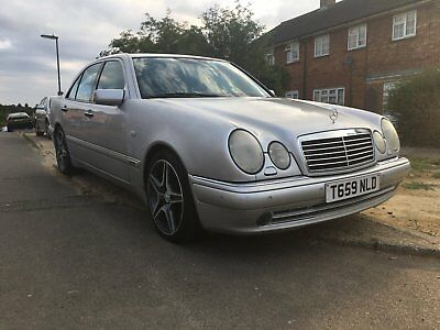 Meredes E55 AMG Silver black leather superb mechanically 3 owners MOT very good