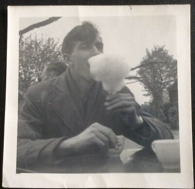 Old Black And White Photo Of A Man Eating Candy Floss