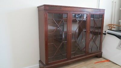 Antique glass fronted mahogany bookcase. Been in family since pre-war.