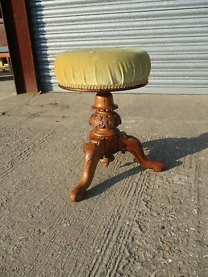 A Victorian Mahogany Revolving Adjustable Piano Stool Stuffed Seat Curved Legs