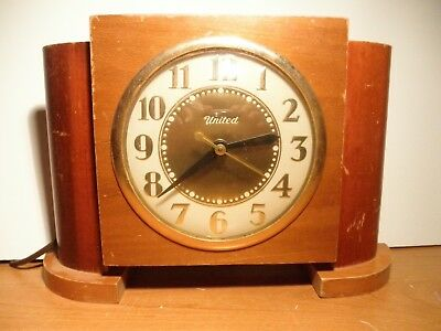 United wood electric towers clock
