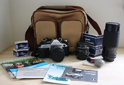 Canon AE-1 SLR Camera plus 2 more lens, instruction manuals and bag plus more!