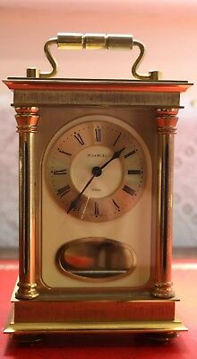 modern carriage clock , eight day pendelum movement,  strikes on a bell