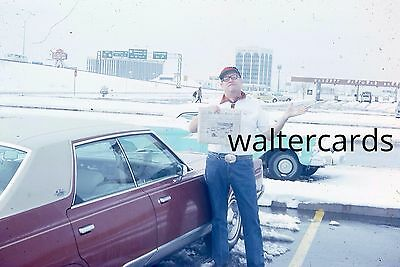 35mm Slide 1960s vintage parked cars lots of snow Man with newspaper highway