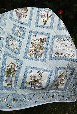 Cotton Cot quilt featuring Dragonflies and Bunnies in blue - gender neutral