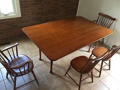 Mid-Century Modern Conant Ball Drop Leaf Table and Four Chairs (2 with arms).