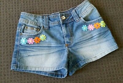 Girls denim shorts size 12 Hand sewn lace on to the shorts