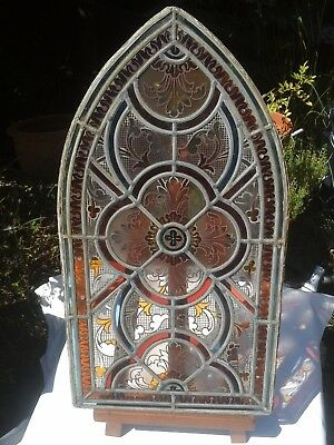 Antique Gothic arch window with amber and clear privacy glass in great condition