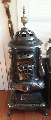antique Nubian Hot Blast wood/coal potbelly parlor stove ( display or parts)