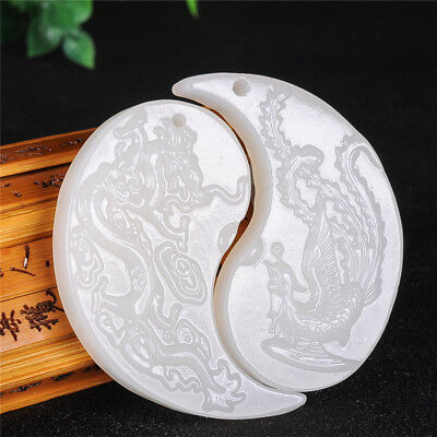 A pair of lover's Chinese white jade hand-carved dragon and phoenix pendant