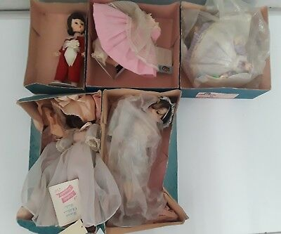 Lot of 5 Madame Alexander dolls with boxs and tags read DESCRIPTION