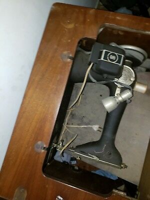 Antique singer sewing machine in cabinet