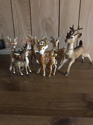 A Lot Of Seven Plastic Christmas Reindeer