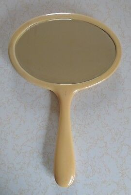 Large vintage celluloid hand mirror with bevelled edge