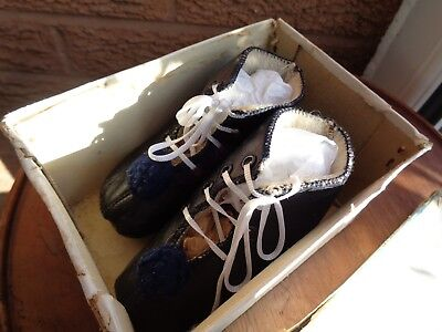 A pair of very sweet antique French black leather baby boots in original box