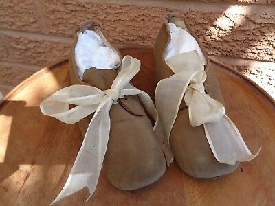 A pair of lovely antique Edwardian girls suede shoes with bows by Drew