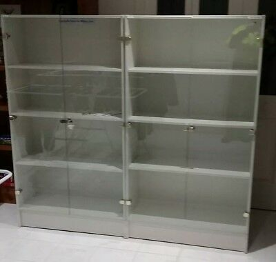 DISPLAY CABINETS WITH LOCKABLE GLASS DOORS (Matching pair).