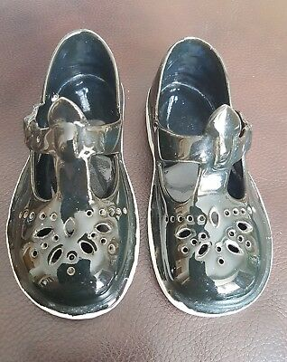 Pair Of Vintage Black Ceramic Shoes