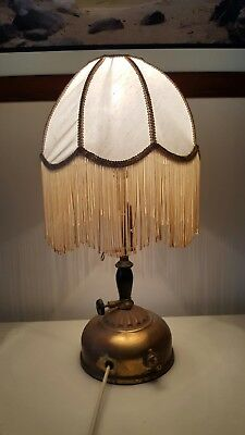 Vintage looking kerosene electrical lamp with long tasselled shade
