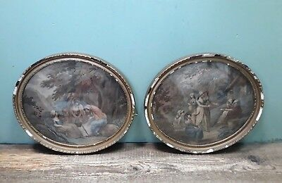 A pair of antique fine art prints in oval gilt frames with notable ageing J8