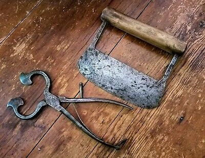 2 18th c hand forged iron items a sugar nippers and a chopper