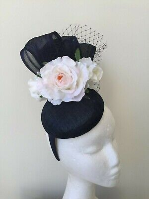 New navy fascinator with 3 white flowers and black netting on a headband!