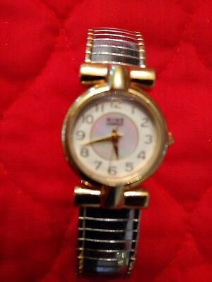 Nine And Company Watch With Mother Of Pearl Face And Gold And Silver Watch Band