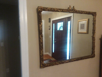 Large antique mirror with ornate gilded frame