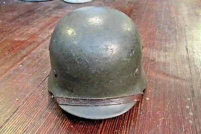 All original German WWII helmet with leather liner & chin strap. D19 Size NS66