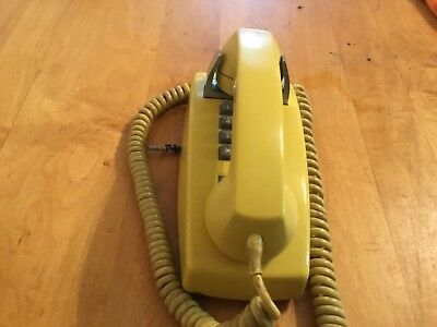 Vintage yellow Western Electric 2554B  12-button Touch-Tone wall telephone  1974
