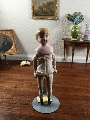 Antique Porcelain Shoulder Head Girl Doll with Cloth Body Blonde Hair Marked