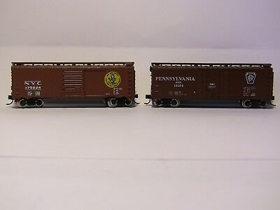 N Scale - 2 ATLAS x 40' boxcars - PENNSY and NYC, both with MTL couplings