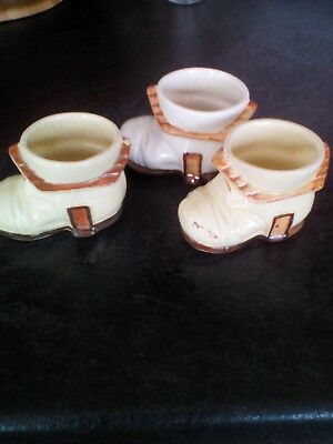 vintage egg cups shaped like boots