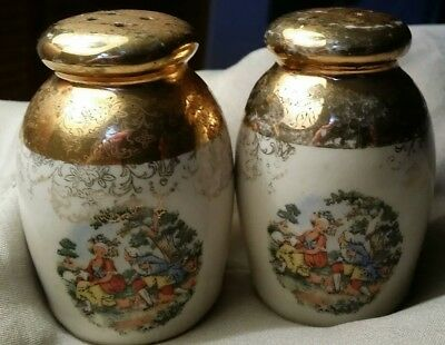 Vintage salt & pepper shakers with gold paint & french colonial man & woman...