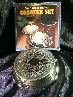 Set six vintage silver plated coasters and bottle coaster from Reader's Digest