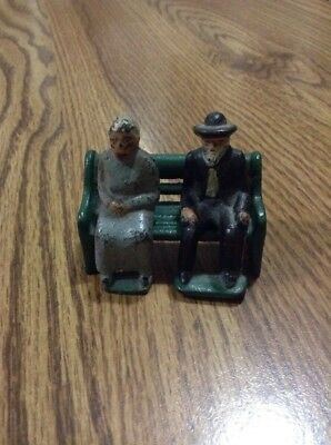 Early Antique Cast Iron Metal Toy Man and Woman Sitting on a Bench Removable