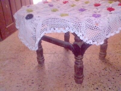 Hand knitted table cover