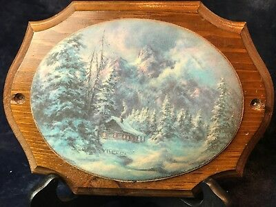 Vintage painting of a snowy cabin scene mounted on a wood plaque by V. Parkinson