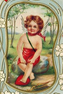 Antique Valentines Day Postcard Cupid Sits On Rock Heart @ Feet Whitney EMB 1915