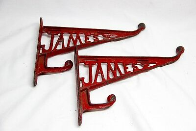 TWO Vintage Original JAMES Harness Saddle Barn Horse Cast Iron Hook Arena Stable