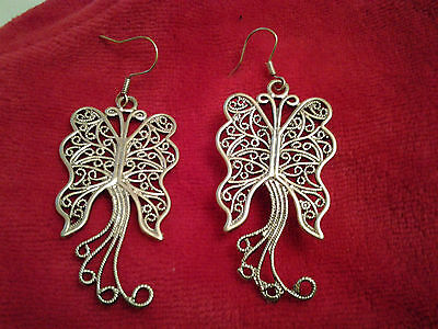 A pair of hand made alloy engraved earrings with butterfly shape, silver colour