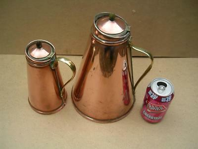 Two fine W A S Benson Arts and Crafts copper jugs. 10.5 and 8.25 inches.