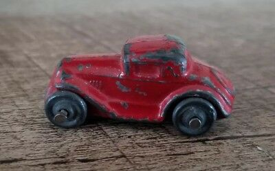 """Antique Red Toy Metal Very  Small Car  Ford Early 1900's 1- 5/8"""" X 3/4"""""""